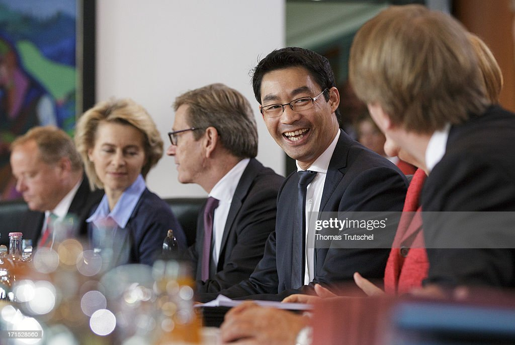 German Economy Minister and Vice Chancellor <a gi-track='captionPersonalityLinkClicked' href=/galleries/search?phrase=Philipp+Roesler&family=editorial&specificpeople=4838791 ng-click='$event.stopPropagation()'>Philipp Roesler</a> (center) attends Weekly German Government Cabinet Meeting on June 26 2013 in Berlin, Germany.