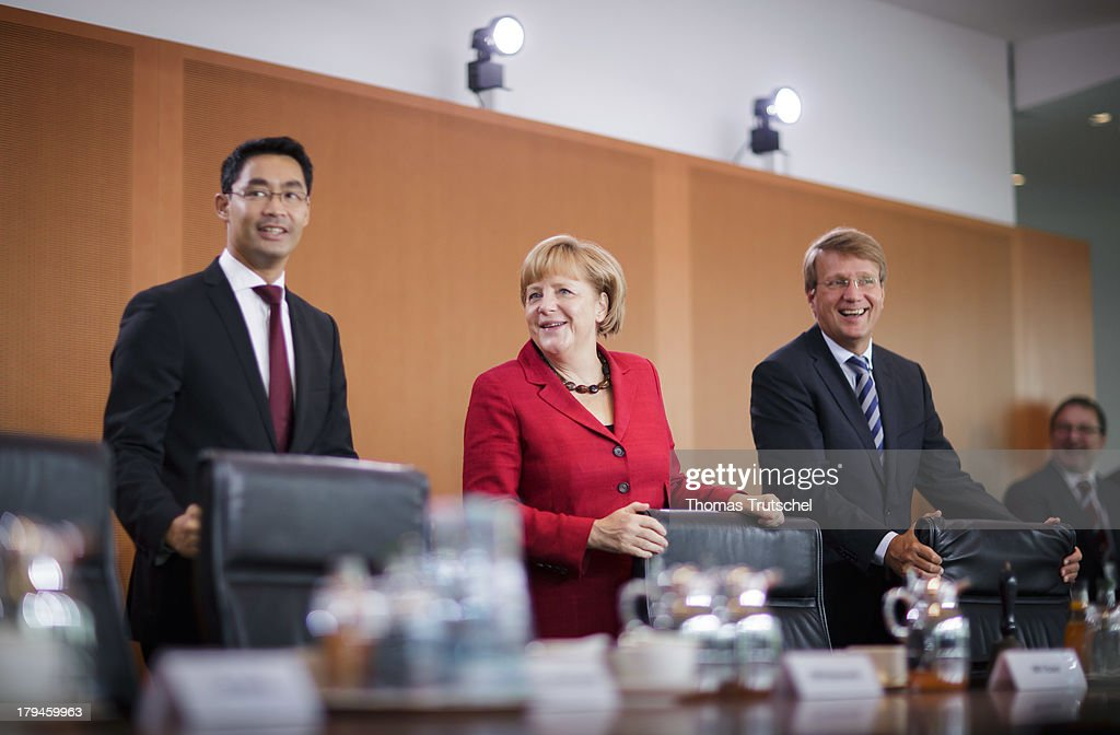 German Economy Minister and Vice Chancellor <a gi-track='captionPersonalityLinkClicked' href=/galleries/search?phrase=Philipp+Roesler&family=editorial&specificpeople=4838791 ng-click='$event.stopPropagation()'>Philipp Roesler</a>, German Chancellor <a gi-track='captionPersonalityLinkClicked' href=/galleries/search?phrase=Angela+Merkel&family=editorial&specificpeople=202161 ng-click='$event.stopPropagation()'>Angela Merkel</a>, and Head of the German Chancellery <a gi-track='captionPersonalityLinkClicked' href=/galleries/search?phrase=Ronald+Pofalla&family=editorial&specificpeople=657117 ng-click='$event.stopPropagation()'>Ronald Pofalla</a>, arrive for the weekly federal Cabinet meeting on September 04, 2013 in Berlin, Germany.