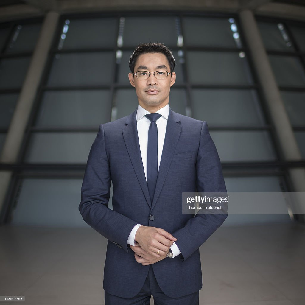 German Economy Minister and Vice Chancellor <a gi-track='captionPersonalityLinkClicked' href=/galleries/search?phrase=Philipp+Roesler&family=editorial&specificpeople=4838791 ng-click='$event.stopPropagation()'>Philipp Roesler</a> poses for a photograph during a portrait session on May 17, 2013 in Berlin, Germany.