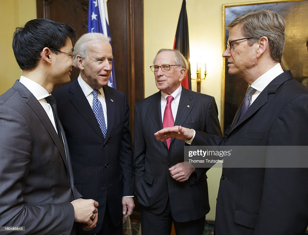 German Economy Minister and Vice Chancellor Philipp Roesler, U.S. Vice President Joe Biden, U.S. Senator Sam Nunn, and German Foreign Minister Guido Westerwelle talking during the Reception on the occasion of the award of the large Bundesverdienstkreuz with Star of the Federal Republic of Germany to U.S. Senator Sam Nunn on day 1 of the 49th Munich Security Conference at Hotel Bayerischer Hof on February 1, 2013 in Munich, Germany. The Munich Security Conference brings together senior figures from around the world to engage in an intensive debate on current and future security challenges and remains the most important independent forum for the exchange of views by international security policy decision-makers.