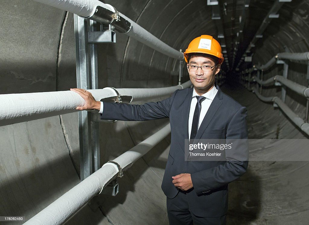 German Economy Minister and Vice Chancellor Philipp Roesler visits an electricity network station on August 28, 2013 in Berlin, Germany. The guarantee of electrical power supply is important for the realization of the Renewable Energy Sources Act.