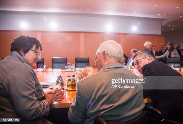 German economy minister Brigitte Zypries finance minister Wolfgang Schaeuble and interior minister Thomas de Maiziere confer prior to the weekly...