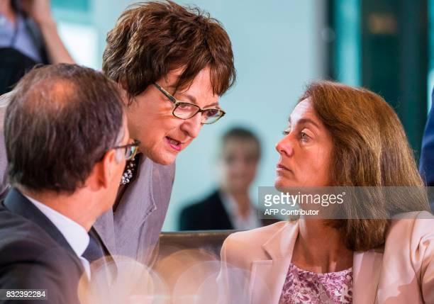 German economy minister Brigitte Zypries justice minister Heiko Maas and family minister Katarina Barley confer prior to the weekly cabinet meeting...