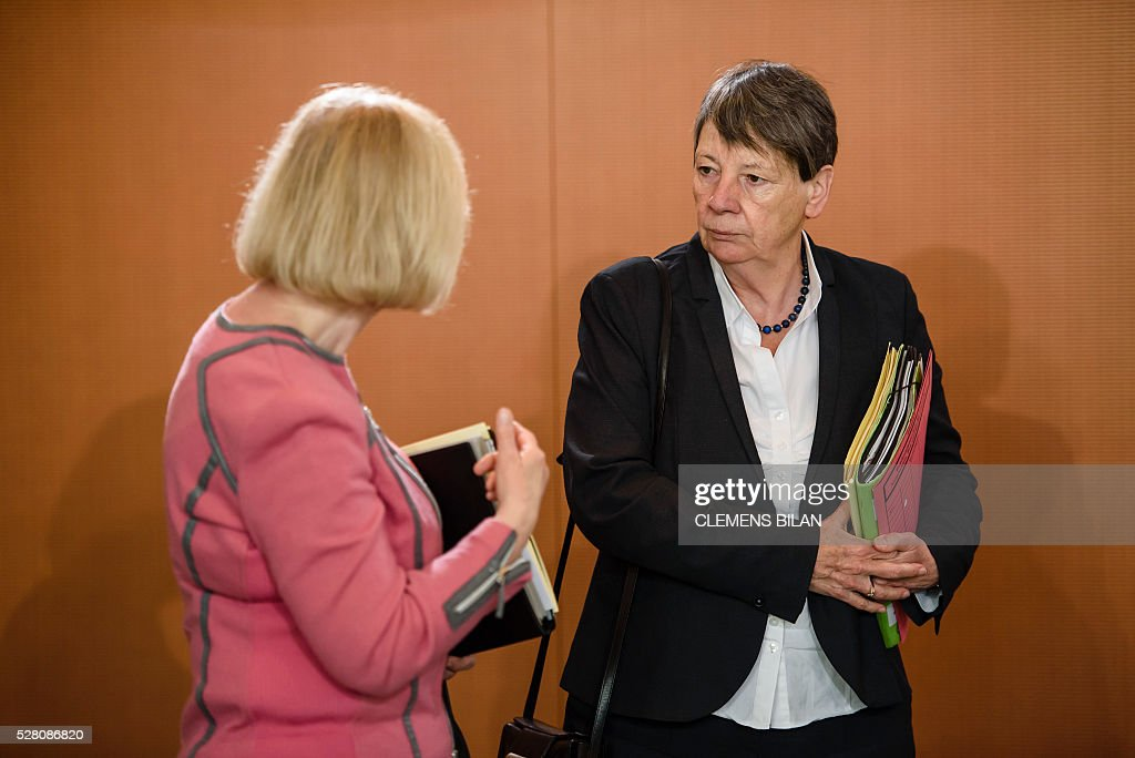German Education and Research Minister Johanna Wanka (L) talks with German Environment Minister Barbara Hendricks prior to the weekly cabinet meeting at the Federal Chancellery in Berlin, on May 4, 2016. / AFP / CLEMENS