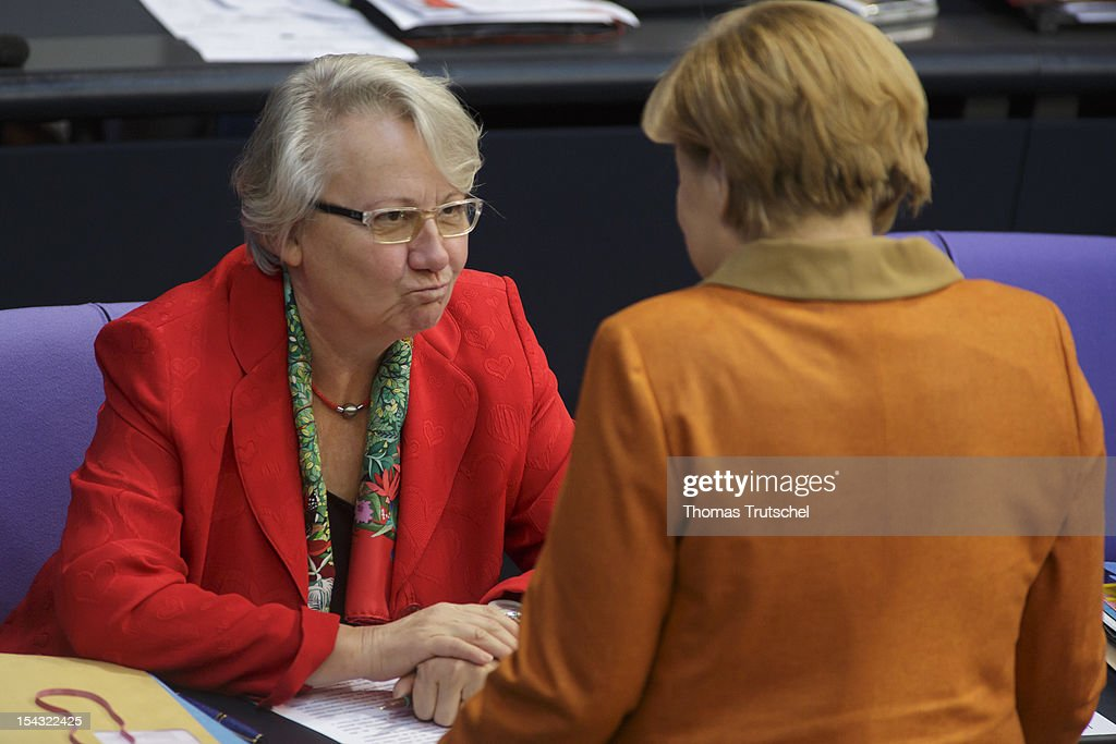 German Education Minister <a gi-track='captionPersonalityLinkClicked' href=/galleries/search?phrase=Annette+Schavan&family=editorial&specificpeople=599358 ng-click='$event.stopPropagation()'>Annette Schavan</a> (L) and German Chancellor <a gi-track='captionPersonalityLinkClicked' href=/galleries/search?phrase=Angela+Merkel&family=editorial&specificpeople=202161 ng-click='$event.stopPropagation()'>Angela Merkel</a> speak at Reichstag, the seat of the German Parliament (Bundestag), on October 18, 2012 in Berlin, Germany. European Union leaders are expected to focus on economic and monetary policies as they gather for the two-day Autumn meeting starting today in Brussels.