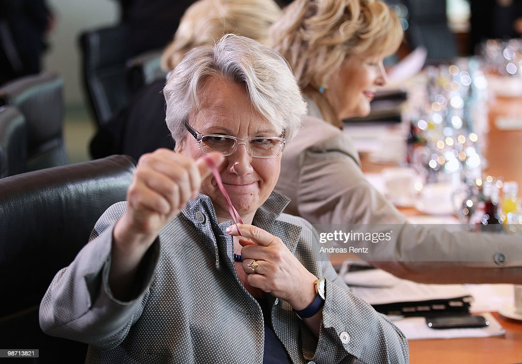 German Education Minister <a gi-track='captionPersonalityLinkClicked' href=/galleries/search?phrase=Annette+Schavan&family=editorial&specificpeople=599358 ng-click='$event.stopPropagation()'>Annette Schavan</a> pulls a rubber band in her hands prior to the weekly German government cabinet meeting at the Chancellery (Bundeskanzleramt) on April 28, 2010 in Berlin, Germany. High on the morning's agenda was a debate about the vocational education report 2010.
