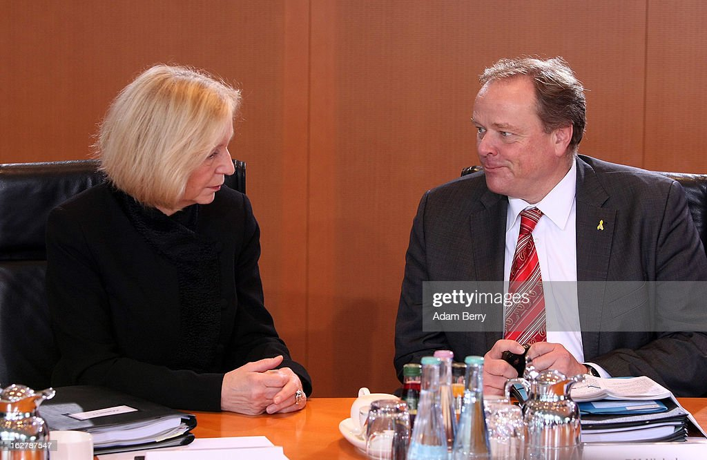 German Education Minister <a gi-track='captionPersonalityLinkClicked' href=/galleries/search?phrase=Johanna+Wanka&family=editorial&specificpeople=5626570 ng-click='$event.stopPropagation()'>Johanna Wanka</a> (L) and German Economic Cooperation and Development Minister Minister <a gi-track='captionPersonalityLinkClicked' href=/galleries/search?phrase=Dirk+Niebel&family=editorial&specificpeople=710721 ng-click='$event.stopPropagation()'>Dirk Niebel</a> speak to one another as they arrive for the weekly German federal cabinet meeting on February 27, 2013 in Berlin, Germany. High on the morning's agenda was discussion of the country's annual report on disarmament as well as of potential modifications to a law on employment rights for foreigners.