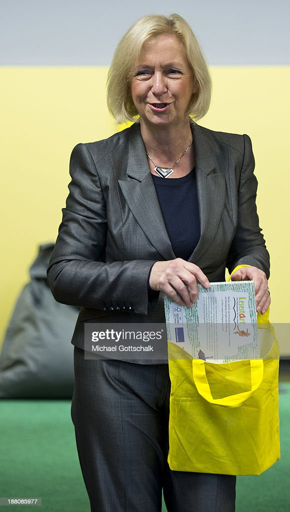 German Education Minister <a gi-track='captionPersonalityLinkClicked' href=/galleries/search?phrase=Johanna+Wanka&family=editorial&specificpeople=5626570 ng-click='$event.stopPropagation()'>Johanna Wanka</a> holds a children's book during the presentation of Project 'Lesestart' in a Libary for Children on November 15, 2013 in Berlin, Germany. The Project offers book packages to parents in 4,500 libaries for Children.