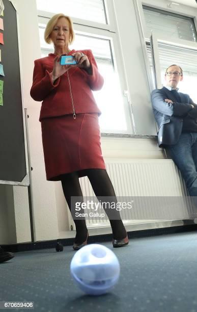 German Education Minister Johanna Wanka operates a Sphero robotic ball during a visit to the Ausbildungverbund Teltow job training center on April 20...