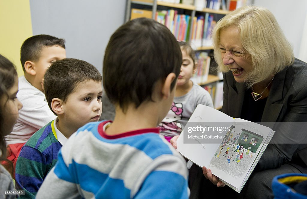 German Education Minister <a gi-track='captionPersonalityLinkClicked' href=/galleries/search?phrase=Johanna+Wanka&family=editorial&specificpeople=5626570 ng-click='$event.stopPropagation()'>Johanna Wanka</a> reads to children during the presentation of Project 'Lesestart' in a Libary for Children on November 15, 2013 in Berlin, Germany. The Project offers book packages to parents in 4,500 libaries for Children.