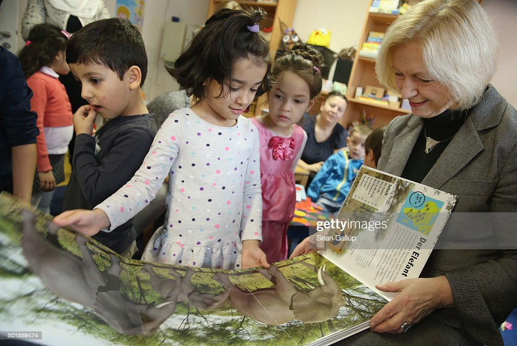 German Education Minister <a gi-track='captionPersonalityLinkClicked' href=/galleries/search?phrase=Johanna+Wanka&family=editorial&specificpeople=5626570 ng-click='$event.stopPropagation()'>Johanna Wanka</a> shares a book about animals with Sahra, 6, from Afghanistan during the presentation of a new initiative to help children of refugees learn to read German at a shelter for migrants and refugees on December 16, 2015 in Berlin, Germany. The initiative, 'Reading Start for Refugee Children,' is being launched by the German Ministry of Education and Research. Germany is expected to receive over one million migrants seeking asylum in 2015 and is seeking a rapid integraiton of the newcomers into society and the job market, for which language instruction is a crucial component.