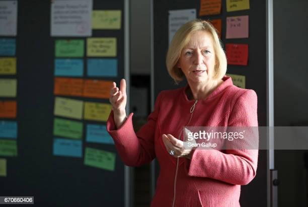 German Education Minister Johanna Wanka speaks to representatives from various job training centers in Berlin during a visit to the Ausbildungverbund...