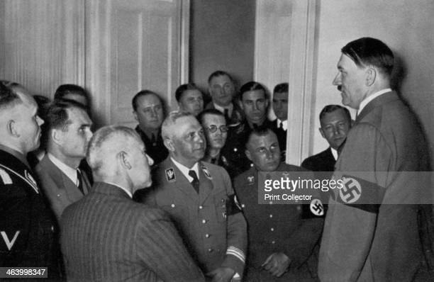 German election and referendum 29 March 1936 Adolf Hitler addressing a group of fellow Nazis A print from Adolf Hitler Bilder aus dem Leben des...