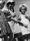 Child's play three girls playing hoopla Photographer Peter Weller 1937Vintage property of ullstein bild