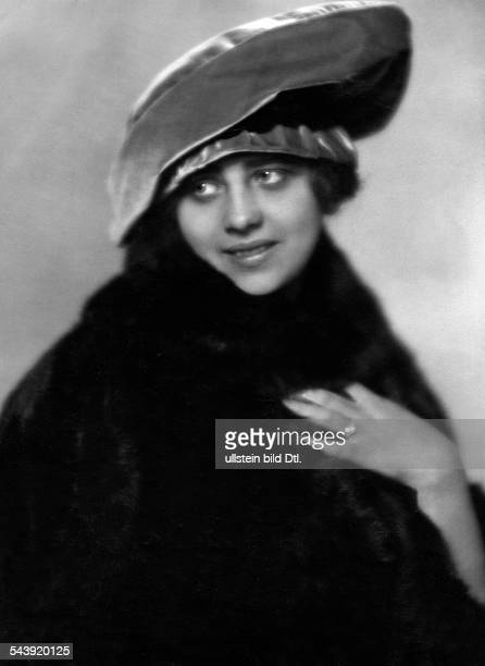 German Empire Fashion woman is wearing a fur coat and a hat Photographer Karl Schenker Published by 'Die Dame' 03/1919Vintage property of ullstein...