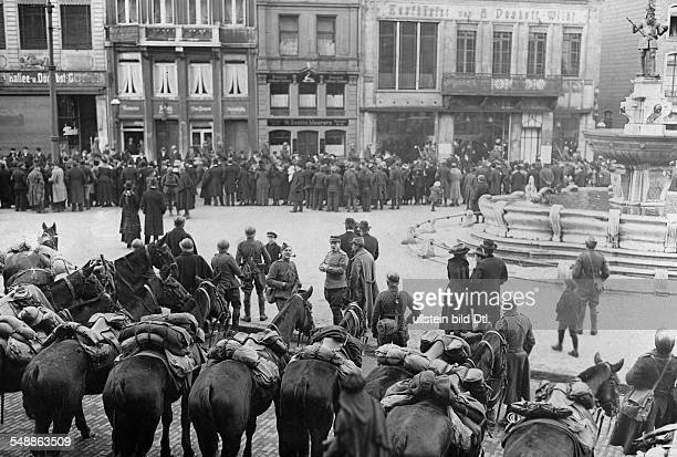 German Empire Kingdom Prussia RhineProvince Aachen Occupation by Belgian troops soldiers concentratin g at the fountain 'Karlsbrunnen' Photographer...