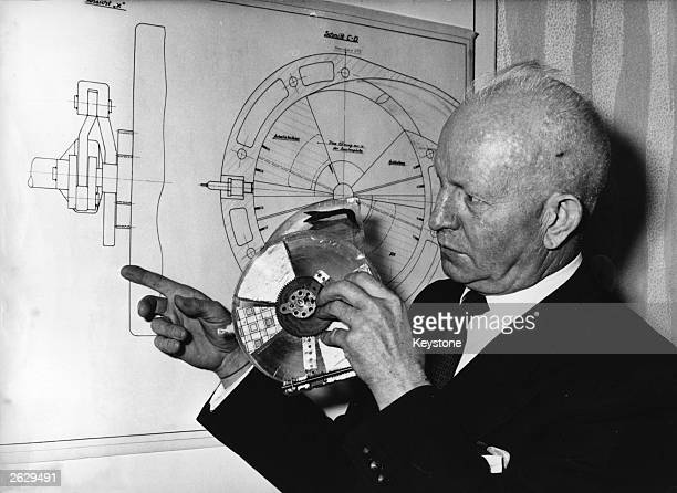 German engineer Eugen Kauertz with his rotary combustion engine for cars