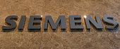 German engineering giant Siemens' logo is pictured in front of the main entrance of the new headquarters in Munich southern Germany on June 14 2016...