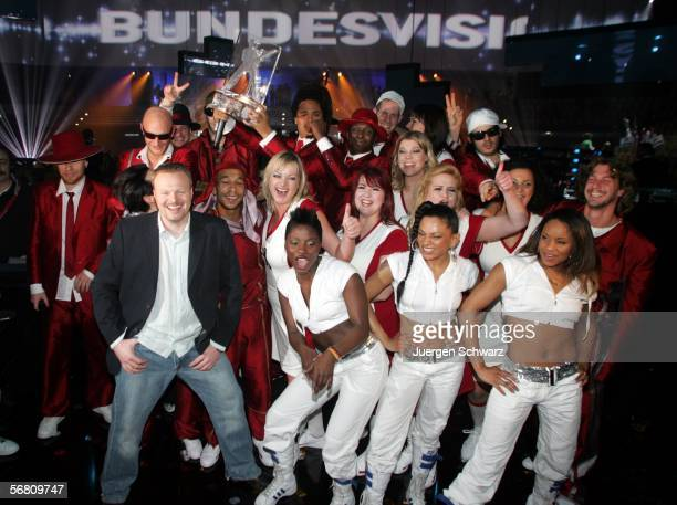 German entertainer and tvhost Stefan Raab and members of the band Seed from Berlin celebrates after winning the Bundesvision Song Contest 2006 on...