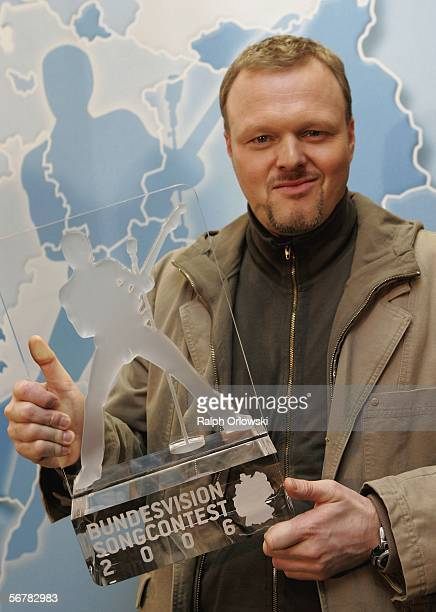 German entertainer and tvhost Stefan Raab displays the trophy of the 'Bundesvision Song Contest 2006' during a press conference on February 8 2006 in...