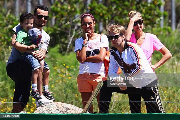 German entertainer Oliver Pocher his wife Alessandra singer Giovanni Zarrella his wife Jana Ina and son Gabriel Bruno watch a Germany training...