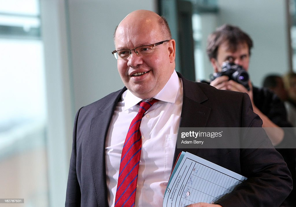 German Environment Minister Peter Altmaier arrives for the weekly German federal cabinet meeting on February 27, 2013 in Berlin, Germany. High on the morning's agenda was discussion of the country's annual report on disarmament as well as of potential modifications to a law on employment rights for foreigners.