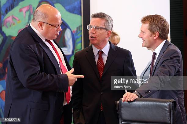 German Environment Minister Peter Altmaier German Defense Minister Thomas de Maiziere and German Health Minister Daniel Bahr arrive for the last...