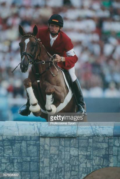 German equestrian Herbert Blocker of the Germany team pictured on his horse Feine Dame during competition to finish in 3rd place to win the bronze...