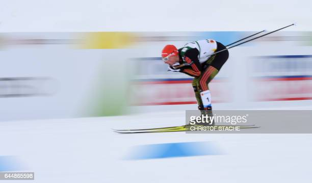 TOPSHOT German Eric Frenzel sledges down during the men's nordic combined 10 km individual Gundersen event of the 2017 FIS Nordic World Ski...