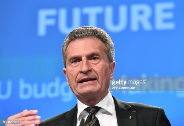 German EU Commissioner for budget and human resources Gunther Oettinger gestures as he addresses a press conference on future of the EU Budget at the...
