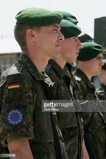 German EUFOR soldiers stand at attention during a visit by German Defense Minister Franz Josef Jung June 22 2006 at the German military base in...