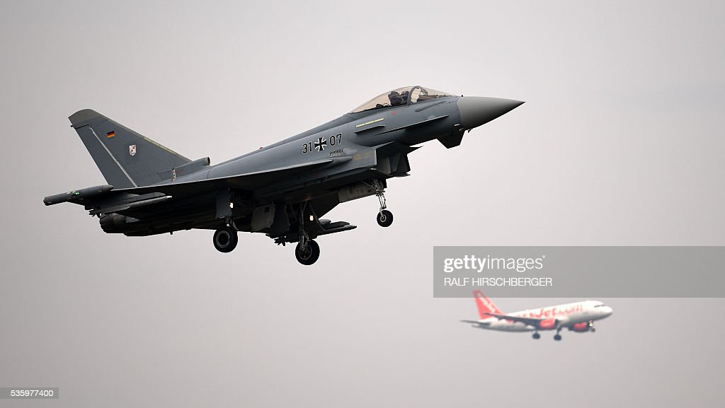 German 'Eurofighter' jet flies during the International Aerospace Exhibition (ILA) in Schoenefeld on May 31, 2016. The Aerospace Exhibition at Schoenefeld Airport near Berlin takes place from June 1 till 4. / AFP / dpa / Ralf Hirschberger / Germany OUT