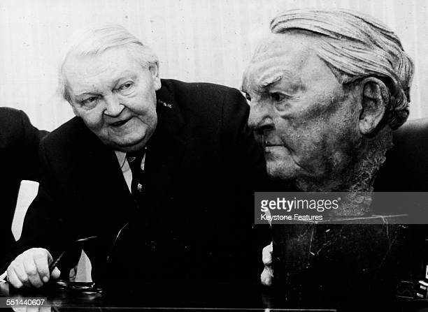 German exChancellor Ludwig Erhard inspecting a marble bust in his likeness created by sculptor Arno Breker February 6th 1973