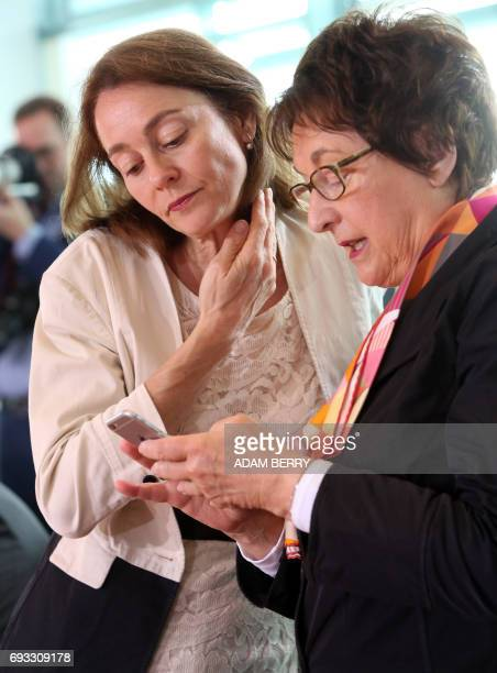 German Family Minister Katarina Barley and German Economy and Energy Minister Brigitte Zypries talk ahead the weekly German Cabinet meeting in Berlin...