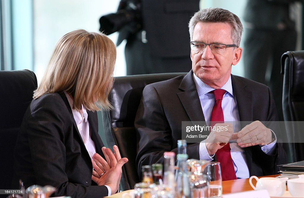 German Family Minister Kristina Schroeder (L) and German Defense Minister <a gi-track='captionPersonalityLinkClicked' href=/galleries/search?phrase=Thomas+de+Maiziere&family=editorial&specificpeople=618845 ng-click='$event.stopPropagation()'>Thomas de Maiziere</a> arrive for the German federal Cabinet meeting on March 20, 2013 in Berlin, Germany. High on the morning's agenda was discussion of proposed laws pertaining to preventative health measures as well as the proposed ban on the right-wing National Democratic Party (Nationaldemokratische Partei Deutschlands, or NPD), which, contrary to a joint bid by Germany's 16 states, the federal government has not supported.