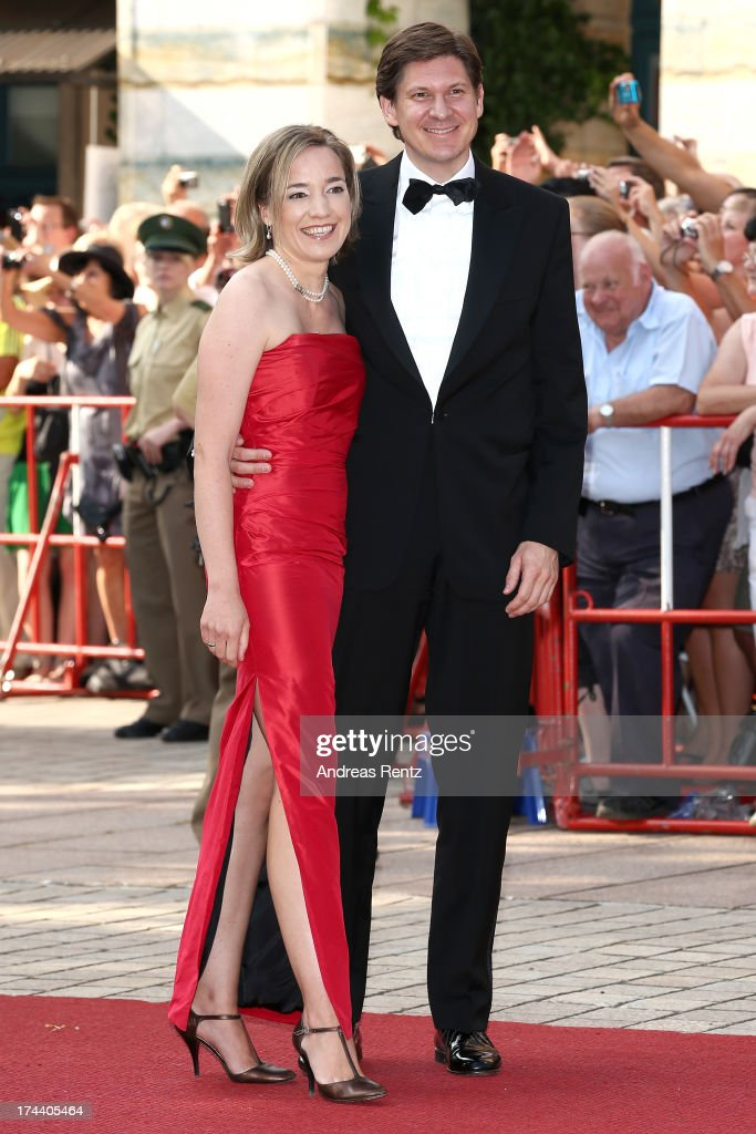 German Family Minister Kristina Schroeder and her husband <a gi-track='captionPersonalityLinkClicked' href=/galleries/search?phrase=Ole+Schroeder&family=editorial&specificpeople=5890176 ng-click='$event.stopPropagation()'>Ole Schroeder</a> attend Bayreuth Festival Opening 2013 on July 25, 2013 in Bayreuth, Germany.