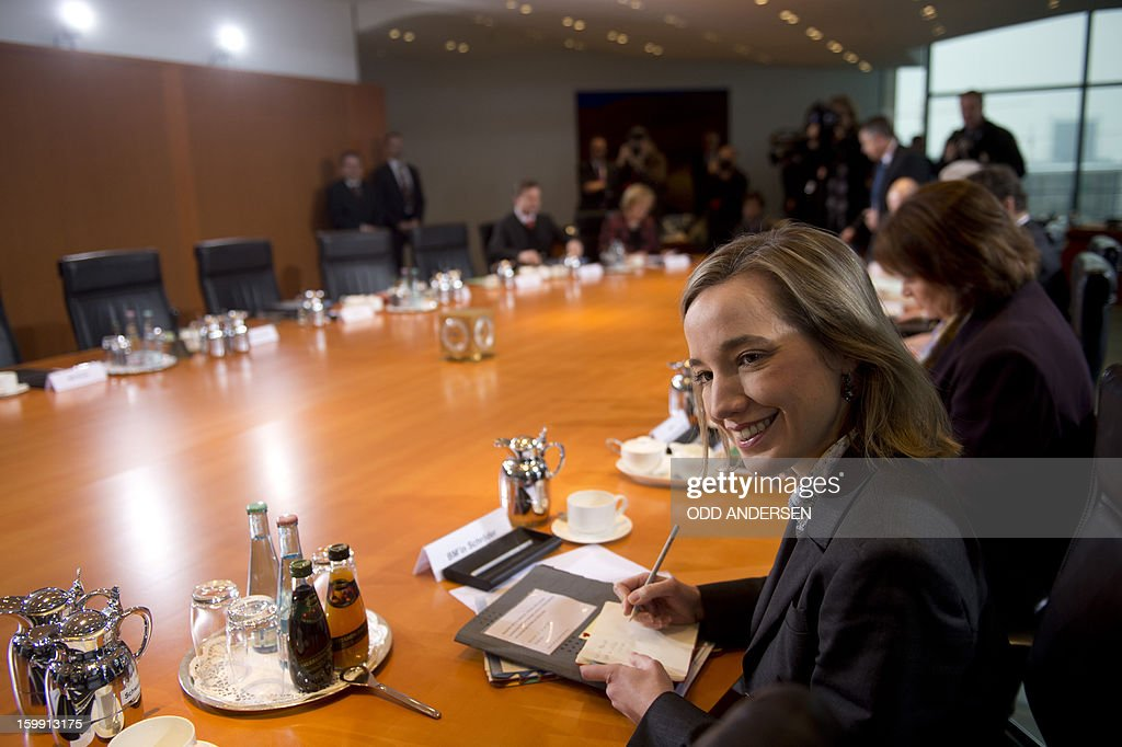 German family minister Kristina Schroeder is seated for the weekly cabinet meeting at the Chancellery in Berlin on January 23, 2013.AFP PHOTO / ODD ANDERSEN