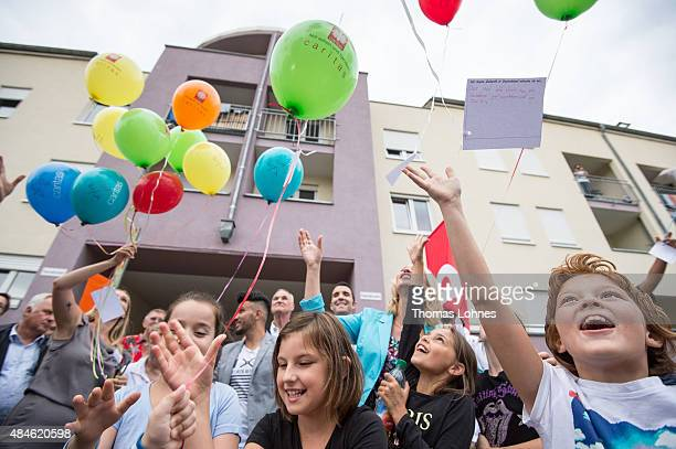German Family Minister Manuela Schwesig and children of asylum applicants write wishes on papers and let them fly with ballons as she visits a...