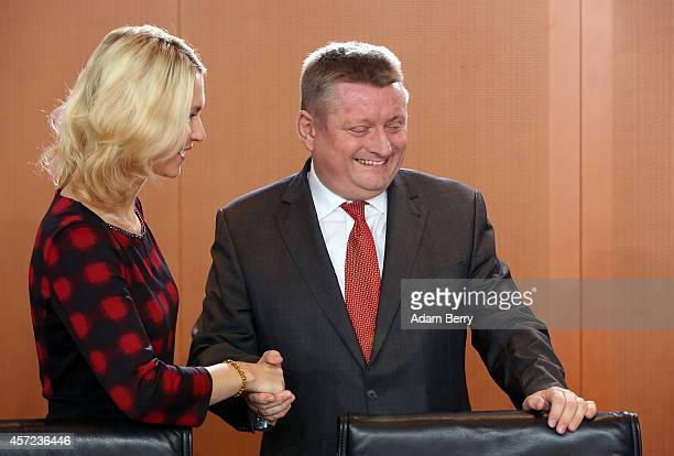 German Family Minister Manuela Schwesig and German Health Minister Hermann Groehe arrive for the weekly German federal Cabinet meeting on October 15...