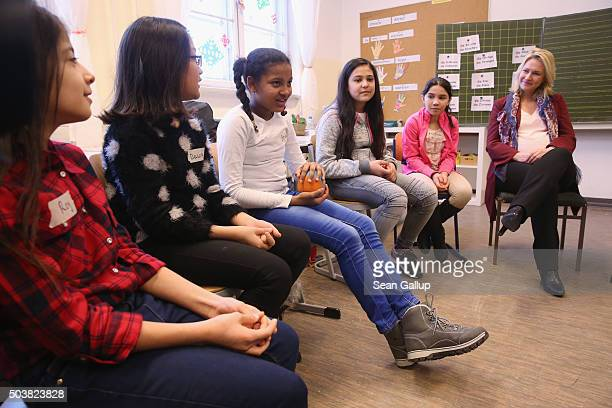German Family Minister Manuela Schwesig chats with pupils at the 'Welcome Class' for immigrant children including children of migrants and refugees...
