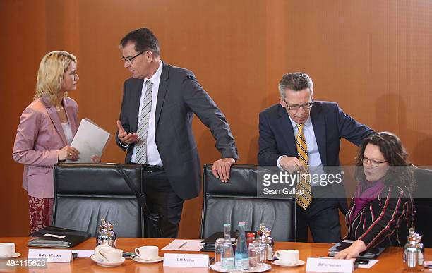German Family Minister Manuela Schwesig Development Minister Gerd Mueller Interior Minister Thomas de Maiziere and Minister of Work and Social Issues...