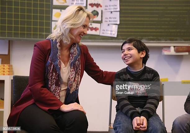 German Family Minister Manuela Schwesig greets Amar a child participating in the 'Welcome Class' for immigrant children including children of...
