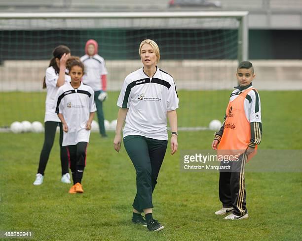 German Family Minister Manuela Schwesig joins a football match with children from the 'Kinder von der Strasse eV' association on May 5 2014 in Berlin...