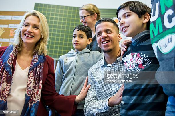 German Family Minister Manuela Schwesig poses with Mohamed Rahal a member of Federal VolunteerService during a visit at the 'Welcome Class' for...