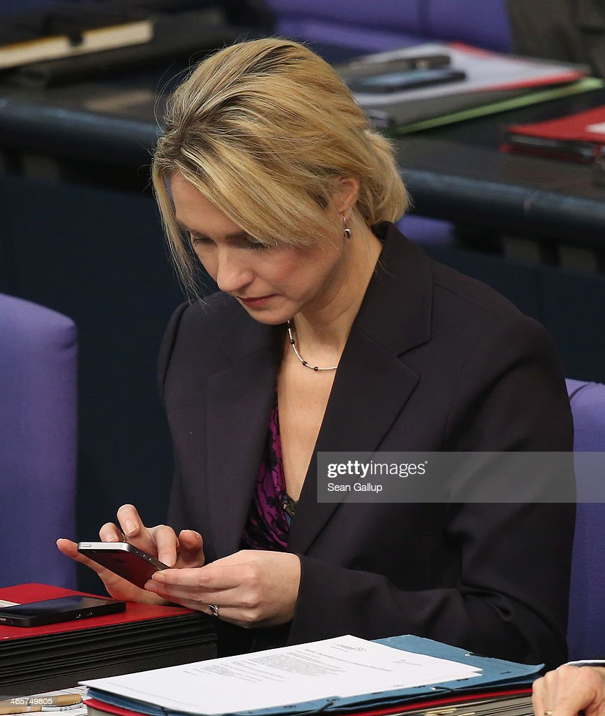 German Family Minister <a gi-track='captionPersonalityLinkClicked' href=/galleries/search?phrase=Manuela+Schwesig&family=editorial&specificpeople=6048691 ng-click='$event.stopPropagation()'>Manuela Schwesig</a> taps on a smartphone as she attends debates at the Bundestag following a government declaration given by German Chancellor Angela Merkel, in which she outlined the policy priorities of the new German coalition government of Christian Democrats and Social Democrats, on January 29, 2104 in Berlin, Germany. Revelations by Edward Snowden in 2013 that the U.S. National Security Agency (NSA) had eavesdropped on the phone of German Chancellor Angela Merkel and other leading European politicians caused a scandal and rift between German and U.S. relations that is still being echoed in current political debates.