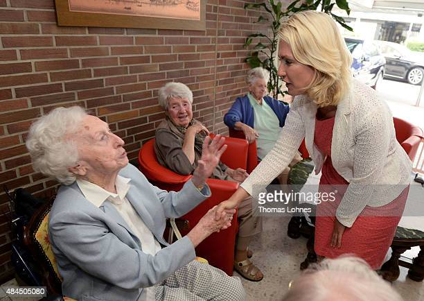 German Family Minister Manuela Schwesig visits the St Martin senior care facility on August 19 2015 in Bingen am Rhein Germany Germany currently has...