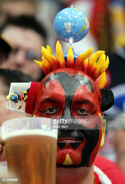 German fan enjoys a beer after Finland went up 20 in the second period during the World Cup of Hockey September 2 2004 at Cologne Arena in Cologne...