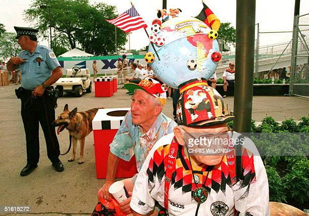 German fan Fritz Hackenberg waits amid some of the security personnel for the gates at Soldier Field to open 17 June 1994 as defending world champion...