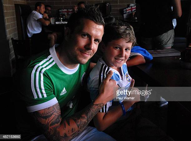 German fan poses with Luca Zambrano from Argentina at the Germany vs Argentina World Cup finals viewing party at the Red Fox English Pub and Grill on...