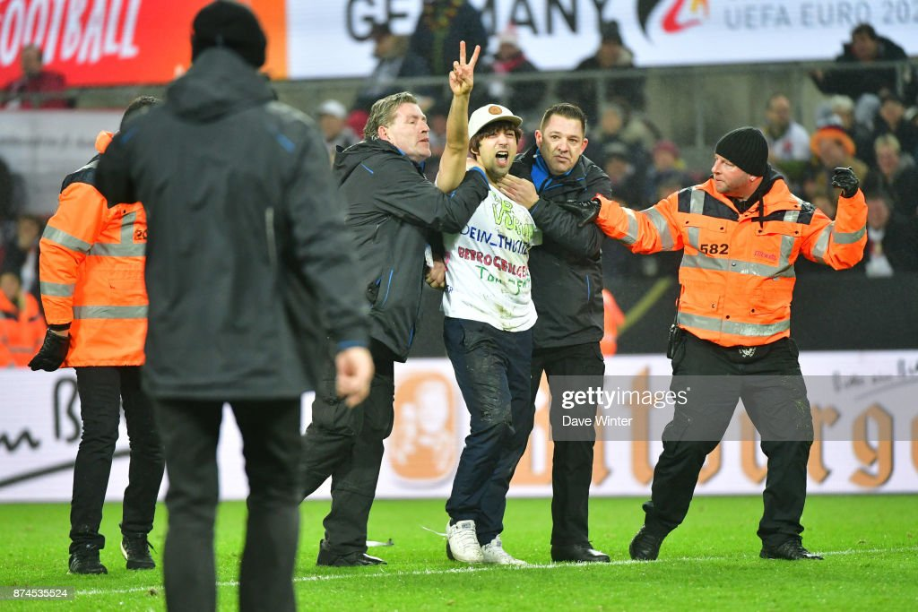 A German fan runs onto the pitch during during the international friendly match between Germany and France at RheinEnergieStadion on November 14, 2017 in Cologne, Germany.